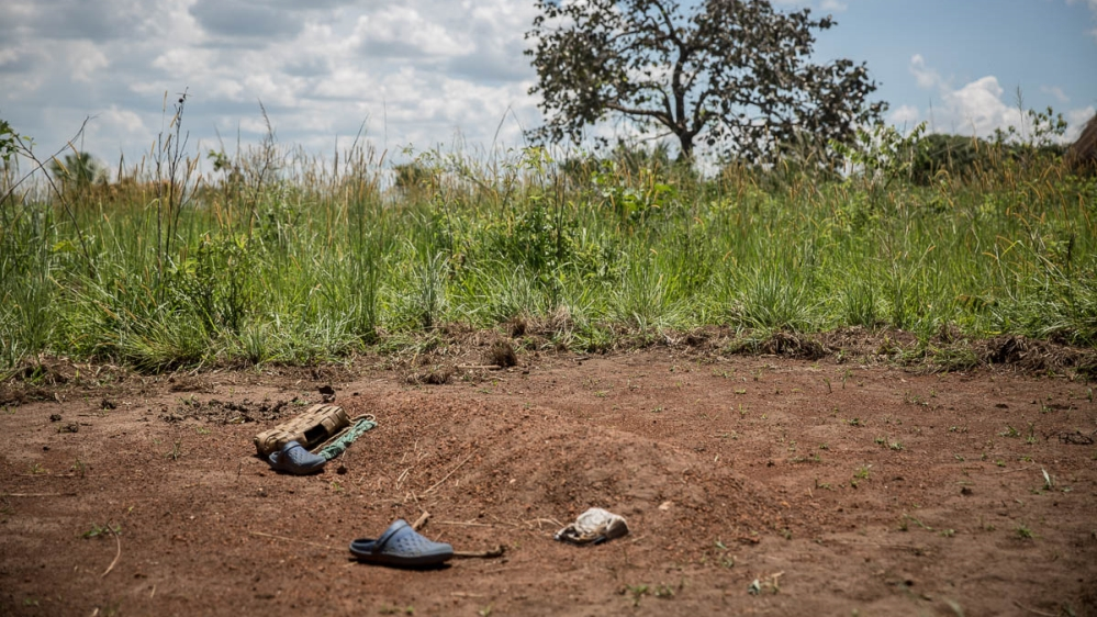 The grave of Stewart Rubamga-Kwo, a 12-year-old who died on March 31 after he was unable to get transport to travel 20km to a hospital. [Sally Hayden/Al Jazeera]