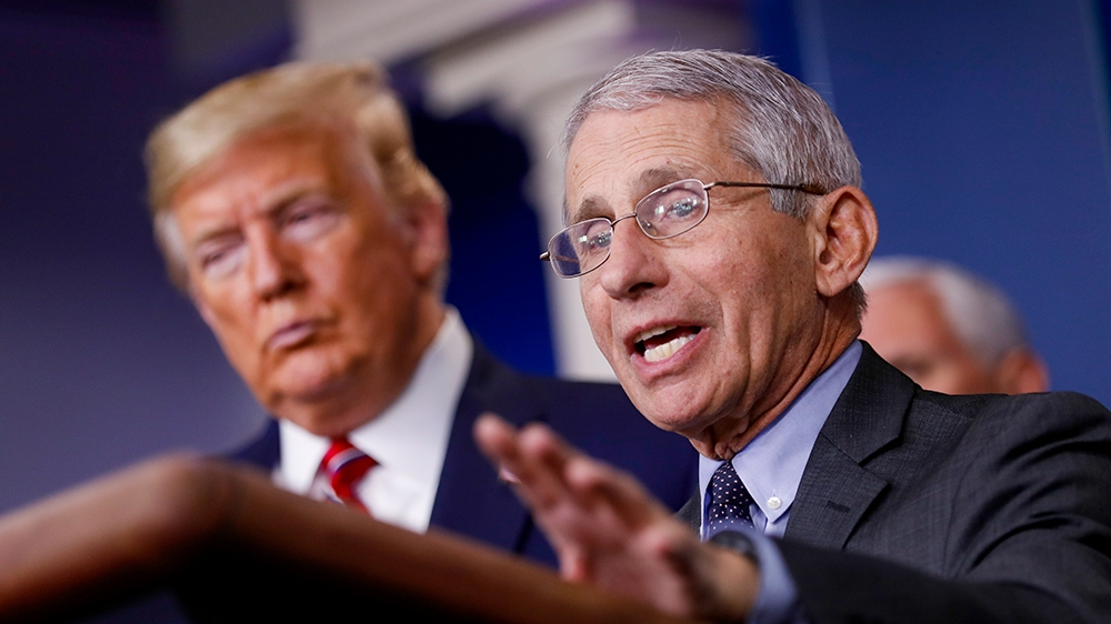 epa08310093 Director of the National Institute of Allergy and Infectious Diseases Anthony Fauci (R) speaks as US President Donald Trump (L) listens during a Coronavirus Task Force news conference in t