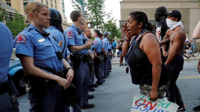 A weeping protester confronts police during nationwide unrest following the death in Minneapolis police custody of George Floyd, in Raleigh, North Carolina, U.S. May 30, 2020. Picture taken May 30, 20