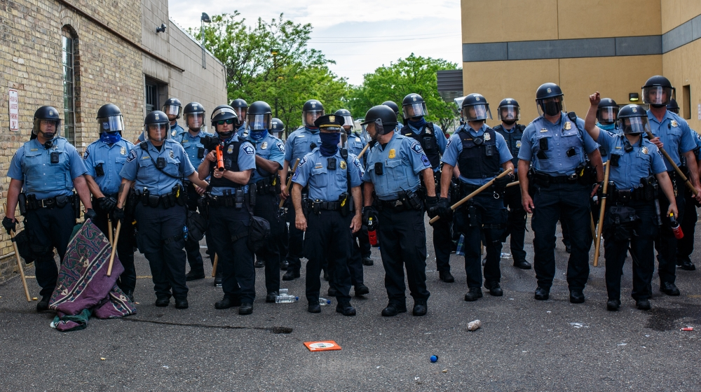 Minneapolise Police officers stand in a line while facing protesters demonstrating against the death of George Floyd outside the 3rd Precinct Police Precinct in Minneapolis, Minnesota. Members of the