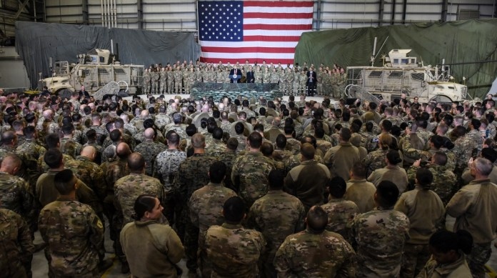 US President Donald Trump speaks to the troops during a surprise Thanksgiving day visit at Bagram Air Field, on November 28, 2019 in Afghanistan. Olivier Douliery / AFP