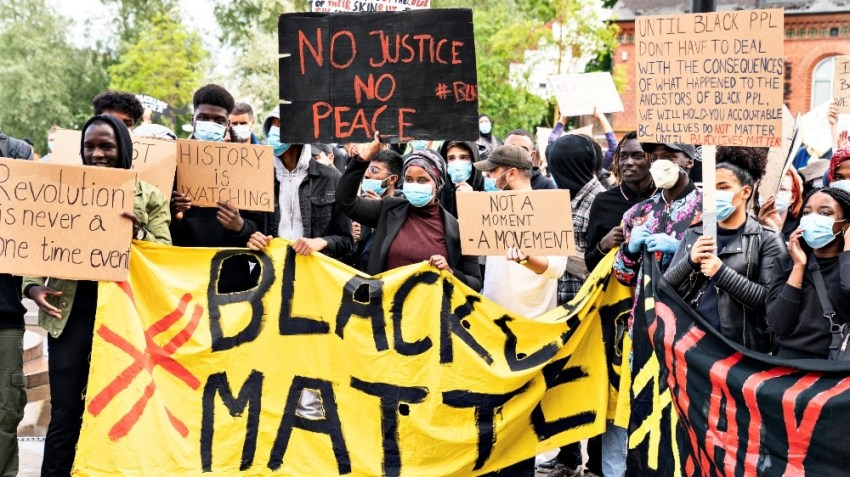 People take part in a demonstration to show solidarity with the Black Lives Matter movement, in Aalborg
