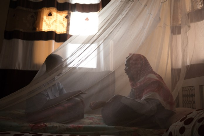 Two children play in a shelter for unaccompanied victims of trafficking in Bosasso, Puntland. Young and gullible, they fell for the trafficker's promise to take them to Dubai to find jobs. 'The man came to the school,' Ali recalled. 'He told us he would get us to Dubai in a few days. I did not tell my parents because I knew they would not agree. I see how much they struggle to feed us, and I thought if I got a job, I would be able to help.' Instead, the smuggler took all their money and abandoned the pair in Bosasso. [Muse Mohammed/IOM]