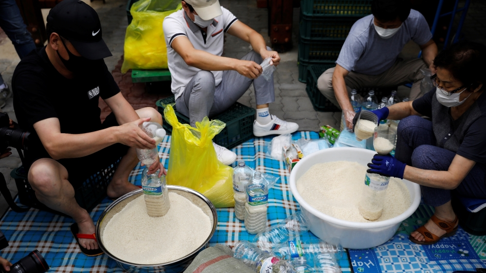 North Korean defector group prepares plastic bottles filled with rice and masks to be sent towards North Korea