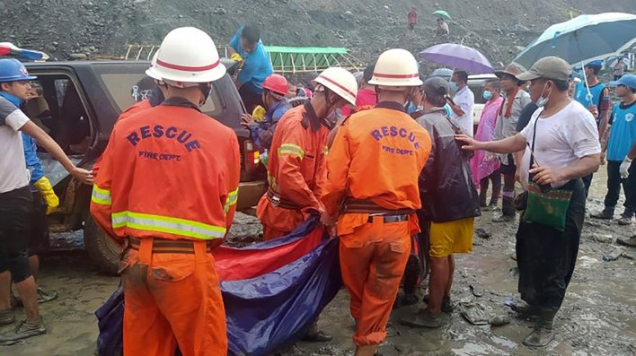 ISO Certificate epa08522220 A handout photo made available by the Myanmar Fire Services Department shows rescue workers carrying the body of a victim after a landslide accident at a jade mining site in Hpakant, Kachi