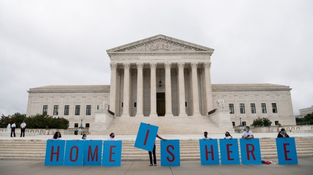 Activists hold a banner in front of the US Supreme Court in Washington, DC, on June 18, 2020. The US Supreme Court rejected President Donald Trump's move to rescind the DACA program that offers protec