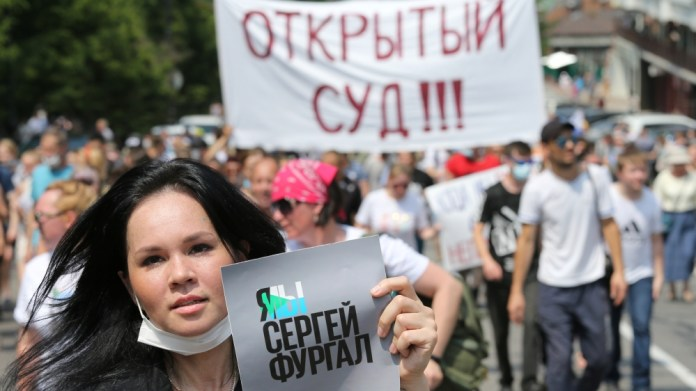 People take part in a rally in support of arrested governor Sergei Furgal in Khabarovsk