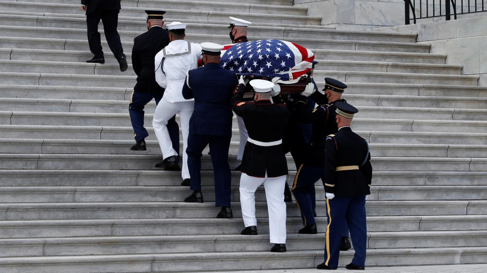 The flag-draped casket of late Rep. John Lewis, (D-GA), is carried by a joint services military honor guard to lie in state at the U.S. Capitol, in Washington, U.S., July 27, 2020. Alex Brandon/Pool v