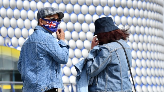 People wearing protective face masks are seen outside the Bullring shopping centre in Birmingham, central England on August 22, 2020, as Britain's second-city, home to more than one million people,