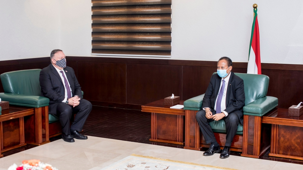 A handout picture provided by Sudan's Prime Ministers office on August 25, 2020, shows US Secretary of State Mike Pompeo (L) meeting with Sudanese Prime Minister Abdalla Hamdok (R) in Khartoum. Pompeo