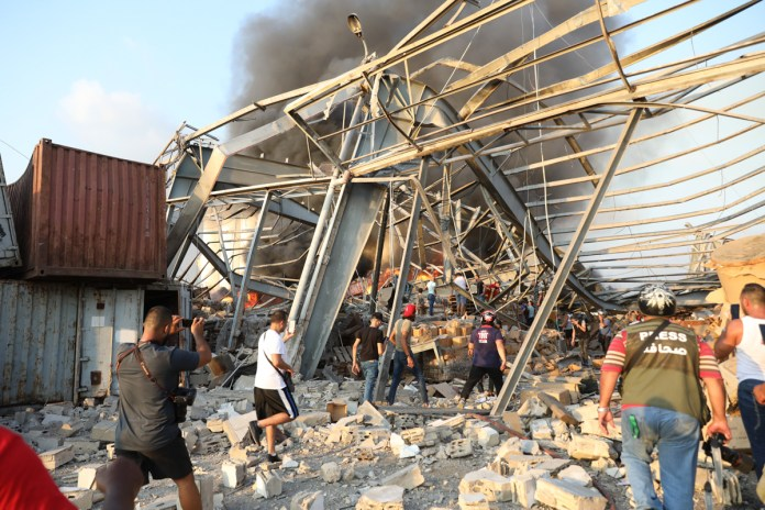 People walk near the scene of the blast. [Anwar Amro/AFP]