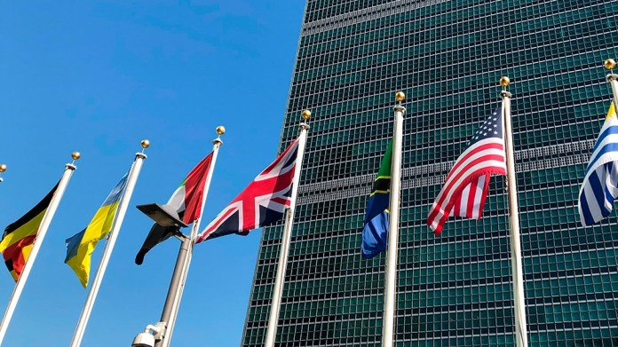 Flags fly outside the United Nations headquarters during the 74th session of the United Nations General Assembly, Saturday, Sept. 28, 2019.  At this year's annual gathering at the United Nations, well
