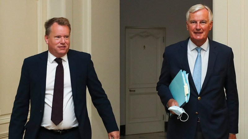 European Union chief Brexit negotiator Michel Barnier, right, and the British Prime Minister's Europe adviser David Frost arrive for Brexit trade talks between the EU and the UK, in Brussels, Friday,