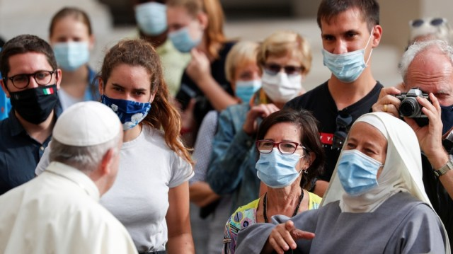 Pope Francis arrives at the first weekly general audience to readmit the public since the coronavirus disease (COVID-19) outbreak, at the Vatican