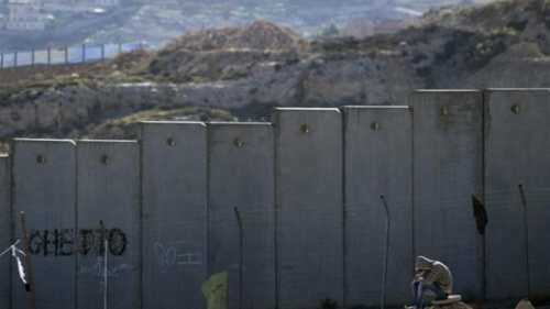 "Israel's expertise in separation fences and walls was put to productive use with the massive ""Apartheid Wall"" it built on Palestinian lands [EPA]"