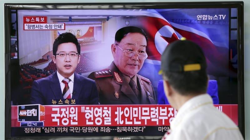 A TV programme reporting that Hyon Yong-chol was killed by anti-aircraft gunfire, in Seoul, South Korea [AP]