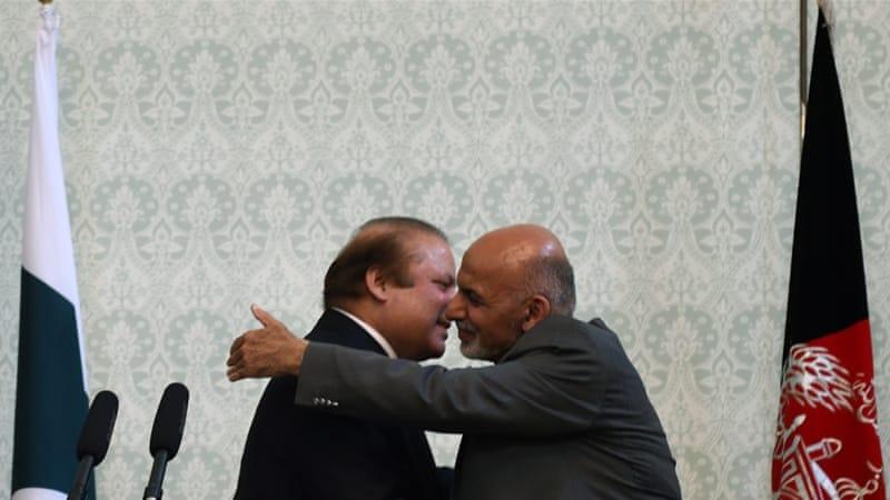 Afghan President Ashraf Ghani embraces Pakistani Prime Minster Nawaz Sharif at the Presidential palace in Kabul [AFP]