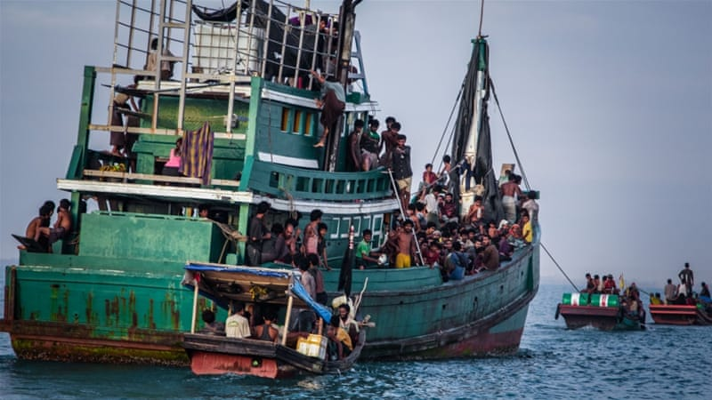 Rohingya migrants on a boat off the coast near Indonesia's East Aceh district of Aceh province before being rescued [AFP]