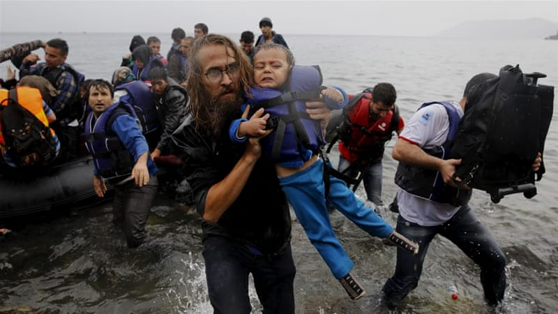 Refugees coming ashore. Reuters image.