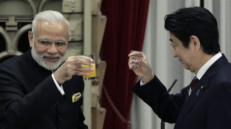 Abe and Modi are seeking to advance business and security cooperation [Kiyoshi Ota/EPA]