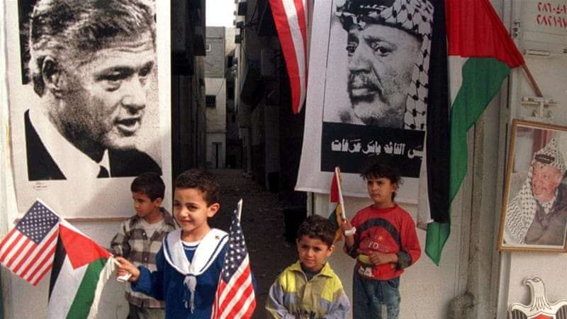 Palestinian children wave US and Palestinian flags in Gaza City on December 9, 1998, several days before the visit of the then US President Bill Clinton [AP]