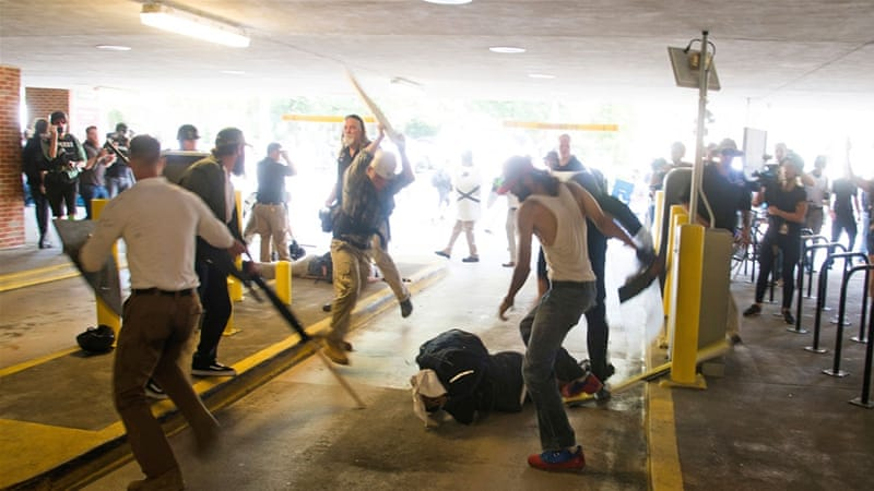DeAndre Harris was assaulted in a parking garage beside the Charlottesville police station after a white nationalist rally was disbursed by police [Zach Roberts/AP Photo]