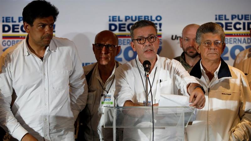 "Gerardo Blyde (C) said Venezuelans were facing ""a very serious moment for the country"" [Carlos Garcia Rawlins/Reuters]"