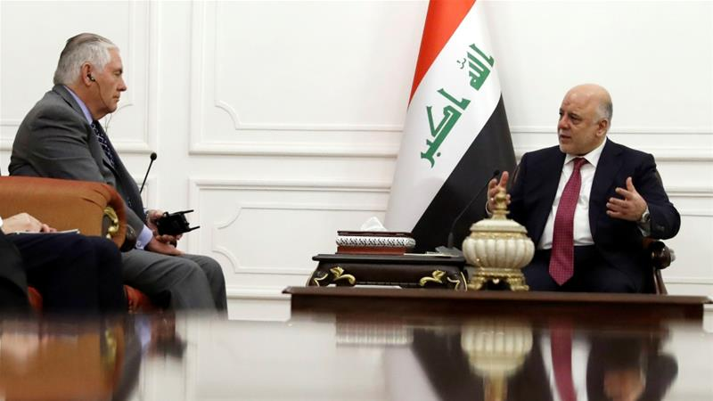 Tillerson (left) and Abadi met on Monday for the second time in two days [Reuters]