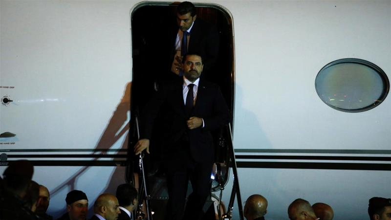 Saad Hariri walks down the steps of a plane at Beirut's international airport [Mohamed Azakir/Reuters]