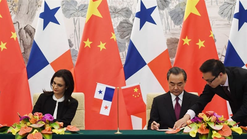 China and Panama's foreign ministers signed a joint communique establishing ties in Beijing [AFP]