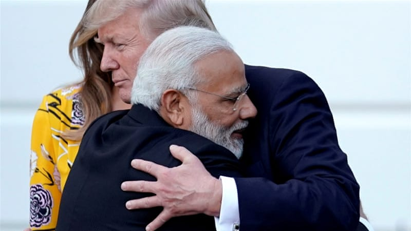 India's Prime Minister Narendra Modi hugs US President Donald Trump after a visit to the White House [Carlos Barria/Reuters]