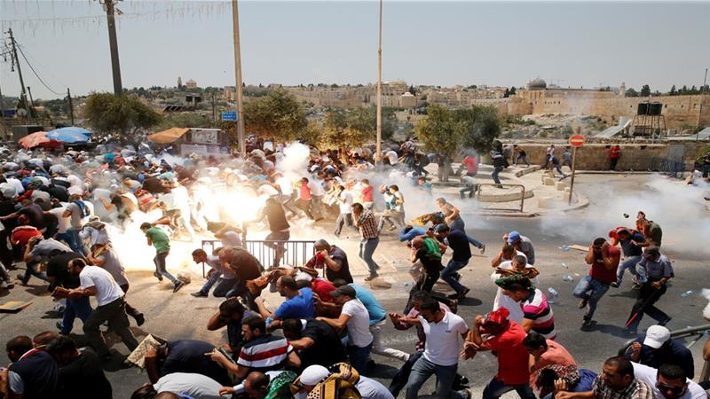 Israeli forces fired tear gas at crowds of Palestinians who protested after Friday prayers in Jerusalem's Old city [Ammar Awad/Reuters]