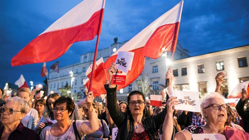 Thousands of protesters took to the streets across Poland urging Duda to exercise his veto [Reuters]