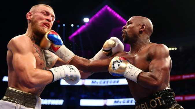 Mayweather stops McGregor to win boxing superfight   USA News   Al     Conor McGregor  L  had vowed to knock Floyd Mayweather  R  out within