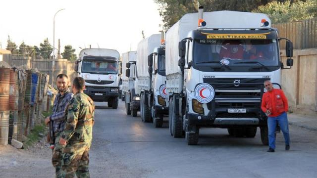 Syrian Arab Red Crescent aid convoys have been supplying foodstuffs to about 12,000 people [Youssef Badawi/[EPA]