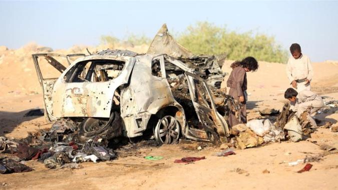 How a Bernie Sanders resolution is normalising the war on terror     Yemeni children inspect the wreckage of a car hit by a drone air raid near  the