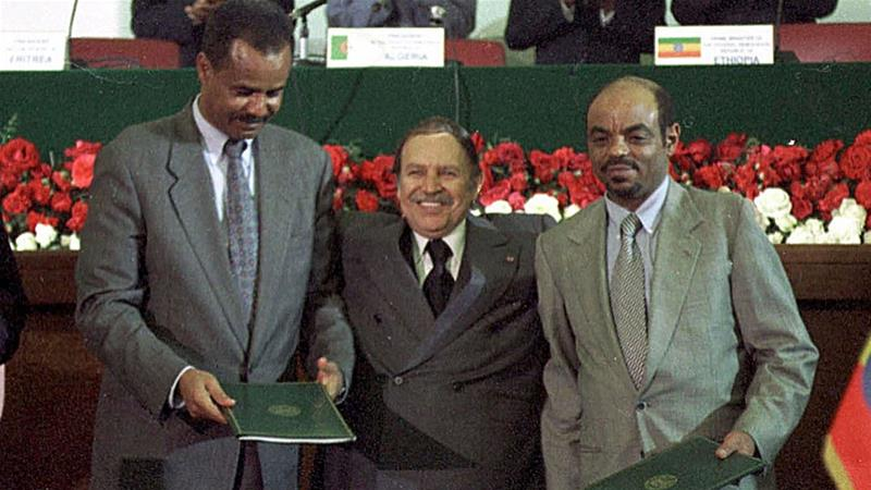 Algerian President Abdelaziz Bouteflika with Ethiopian PM Meles Zenawi and Eritrean President Isaias Afwerki after the signing of a peace agreement on December 12, 2000, in Algiers [AP]