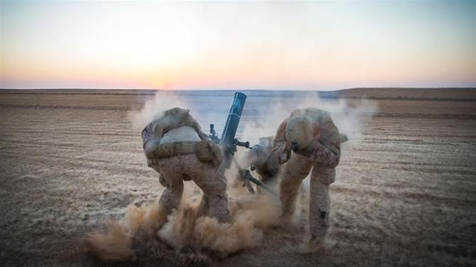 Marines with Weapons Company, 3rd Battalion, 7th Marine Regiment, fire mortars from an undisclosed location in Syria [File/Handout/Marine Corps/Gabino Perez/AP Photo]