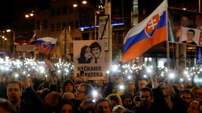 Demonstrators take part in a protest rally marking the first anniversary of the murder of the investigative reporter Jan Kuciak and his fiancee in Bratislava [David W. Cerny/Reuters]
