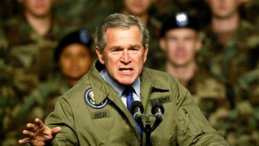 Then President George W Bush is seen addressing the US Army soldiers at Fort Hood, Texas about the possibility of military action against Iraq in January 2003 [File: Jeff Mitchell/Reuters]