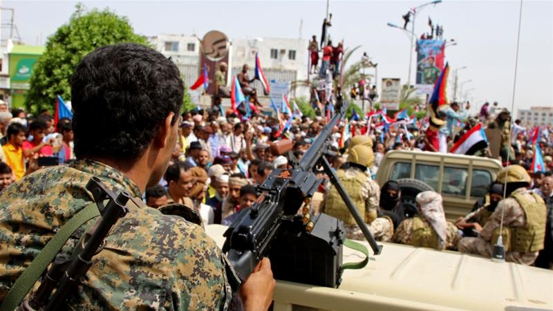 Members of southern separatist forces are seen together with their supporters as they march during a rally in Aden [File: Fawaz Salman/Reuters]