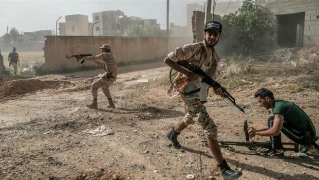Forces from the UN-recognised government take part in 'Operation Peace Storm' against the forces of renegade military commander Khalifa Haftar, south of Tripoli earlier this month [Amru Salahuddien/Anadolu Agency]
