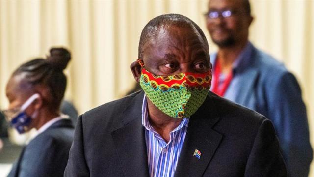 President Cyril Ramaphosa visits a coronavirus treatment facility in Johannesburg in April [Jerome Delay via Reuters]