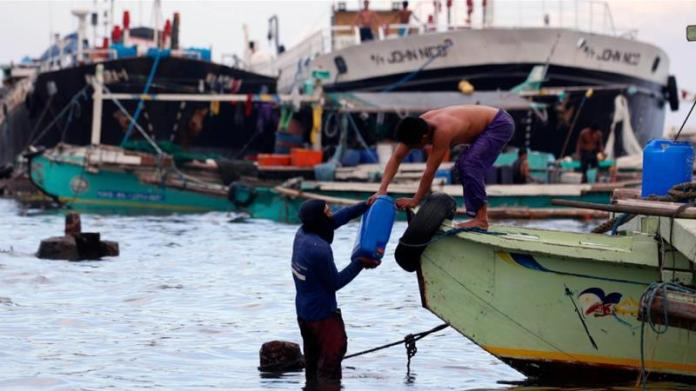 The missing fishermen were heading for the capital, Manila, early on Sunday when the collision happened [File: Francis R Malasig/EPA]