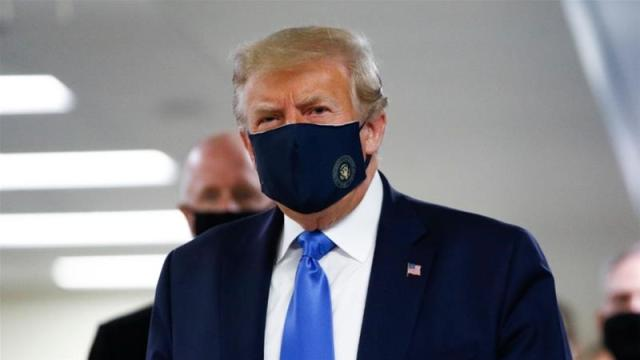 United States President Donald Trump had previously refused to wear a mask in public, or ask other Americans to do so, saying it was a personal choice [Patrick Semansky/AP]