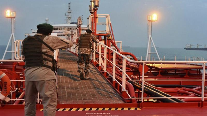 In this July 21, 2019 photo, members of Iran's Revolutionary Guard inspect the British-flagged oil tanker Stena Impero, which was seized in the Strait of Hormuz [Morteza Akhoondi/Mehr News Agency via AP]