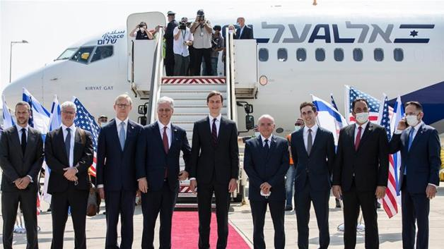 US Presidential Advisor Jared Kushner and National Security Advisor Robert O'Brien pose with members of the US-Israeli delegation to the UAE following a normalisation accord [Heidi Levine/Pool/EPA-EFE]