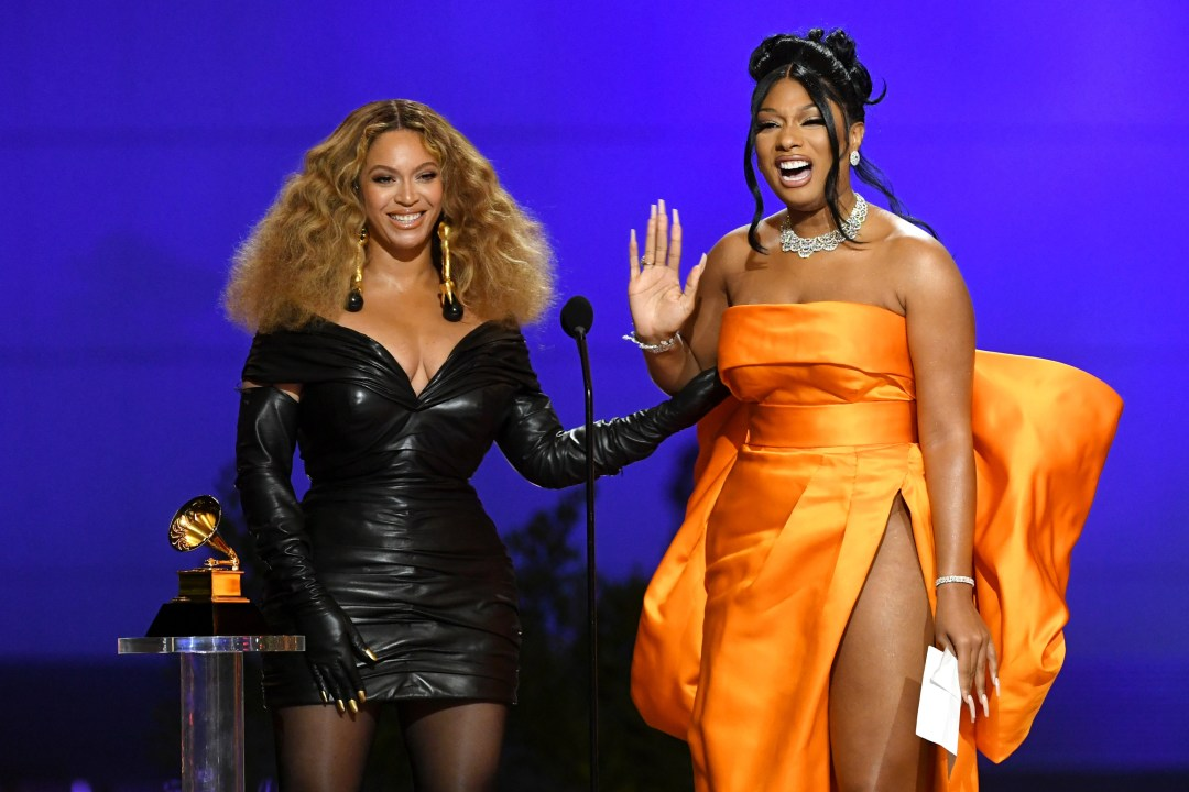 Beyonce (left) and Megan Thee Stallion accept the Best Rap Performance award for Savage at the Grammys on Sunday. Beyonce has won 28 Grammys, the most for any female performer [Kevin Winter/The Recording Academy via EPA]