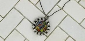 Millefiori pendant with rhinestones