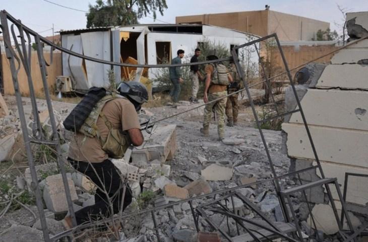 وجود المدنيين يؤخر تقدم القوات شرقا من وسط المدينة حيث يقع مجمع الحكومة الإقليمية - أرشيفية